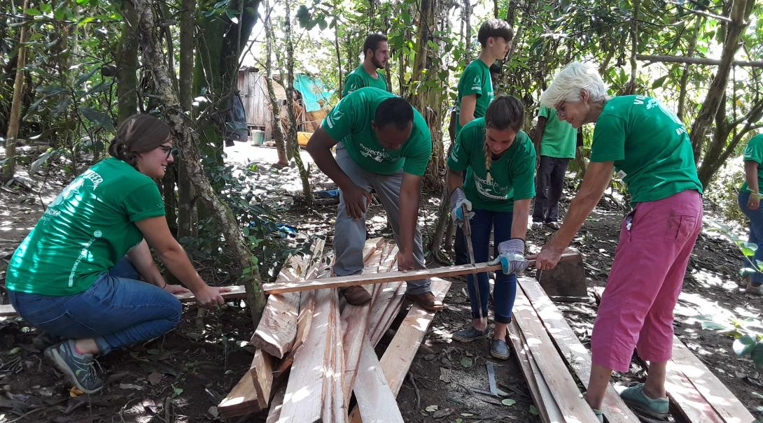 Projects Abroad conservation volunteers and staff build a new camp in the middle of the jungle in Madagascar.